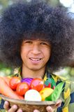 Man holing bucket of colourful vegetables Royalty Free Stock Images