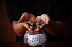 Man holing coins and put money Royalty Free Stock Images
