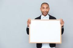 Man holsing whiteboard Royalty Free Stock Image