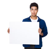 Man holw with white card board Royalty Free Stock Photography