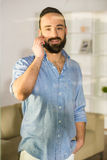 Man at home. Businessman is talking by phone, seen through glass in the living room at home Royalty Free Stock Photos
