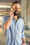 Man at home. Businessman is talking by phone, seen through glass in the living room at home Royalty Free Stock Images