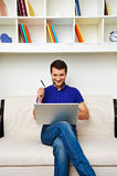 Man at home with credit card and laptop Royalty Free Stock Image
