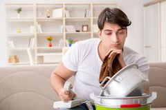 The man at home dealing with neighbor flood leak Royalty Free Stock Photography