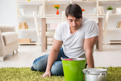 The man at home dealing with neighbor flood leak Stock Images