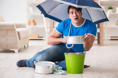 The man at home dealing with neighbor flood leak Royalty Free Stock Image