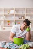 The man at home dealing with neighbor flood leak. Man at home dealing with neighbor flood leak Royalty Free Stock Photography
