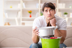 The man at home dealing with neighbor flood leak. Man at home dealing with neighbor flood leak stock images