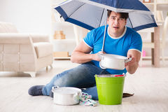 The man at home dealing with neighbor flood leak. Man at home dealing with neighbor flood leak Royalty Free Stock Images