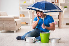 The man at home dealing with neighbor flood leak. Man at home dealing with neighbor flood leak Stock Photos