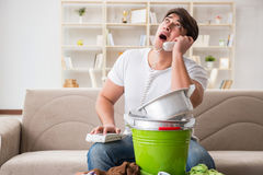 The man at home dealing with neighbor flood leak Stock Photo