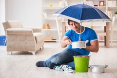 The man at home dealing with neighbor flood leak Royalty Free Stock Photos