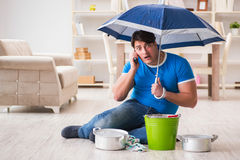 The man at home dealing with neighbor flood leak Stock Image