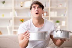 The man at home dealing with neighbor flood leak Royalty Free Stock Photo