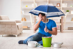 The man at home dealing with neighbor flood leak. Man at home dealing with neighbor flood leak stock photo