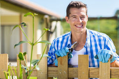 Man home garden fence Royalty Free Stock Photography