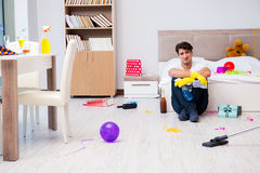 The man at home after heavy partying Stock Photo