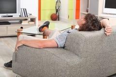 Man at home on his sofa Stock Image