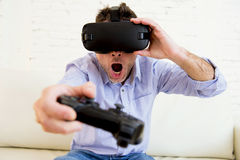 Man at home living room sofa couch excited using 3d goggles play Stock Photos