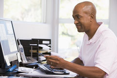 Man in home office using computer Royalty Free Stock Images