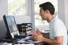 Man in home office using computer Royalty Free Stock Photo
