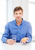 Man at home showing lot of pills Royalty Free Stock Photos
