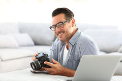 Man at home using camera Stock Photography
