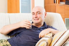 Man at home with water Stock Photos