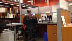 Man Homedepot worker typing information on computer stock video footage