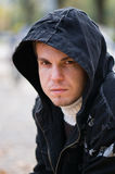 Man in hood. Handsome young man in a black hood Royalty Free Stock Photography