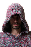 Man in hood. With shadow on face Stock Photography
