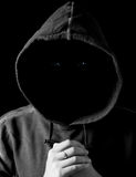 Man in a hood. Portrait of a dark man in a hood without face Stock Image