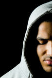 Man with hood. Dark portrait of a young man with hood Stock Photo
