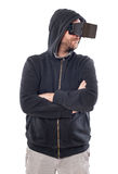Man with hood and crossed arms use a virtual reality device Royalty Free Stock Photo