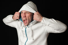 Man in hood. Man in the hood frantically yells Royalty Free Stock Image