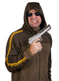 Man in a hood with gun Stock Images