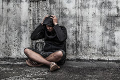 Man in hood with hands on his head Royalty Free Stock Image
