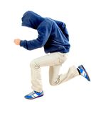 Man with hood jumping Royalty Free Stock Image