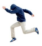 Man with hood jumping Stock Photography