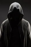 Man in the hood over grey background Stock Images