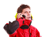 Man in hood with phone Stock Photography