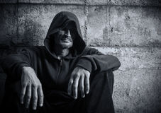 Man in a hood. Portrait of a lonely man in a hood Royalty Free Stock Photo