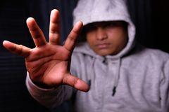 Man with Hood pushing away with his hands, repulsion with stopping hand gesture, Stock Photos