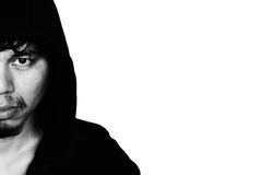Man in hood with scary face isolated on wihte Stock Photos