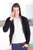 Man with hooded on the phone Stock Image