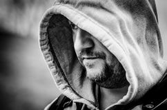 Man in hooded sweater monochrome portrait stock image