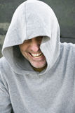 Man in in hooded top. A handsome man wearing a hooded top is laughing.He also has a goatee beard Stock Images