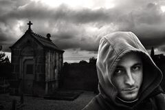 Man in hoodie in cemetery  Royalty Free Stock Photos