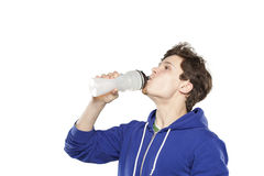 Man in hoodie drinking water Stock Photos