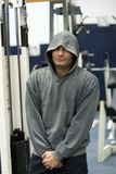 Man with hoodie in gym Stock Photography
